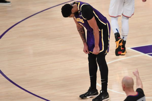 Lakers win in OT; AD 'hurting,' iffy to play Wed.