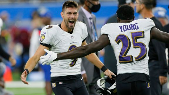Baltimore Ravens kicker Justin Tucker (9) celebrates with Tavon Young (25) after kicking a 66-yard field goal in the second half of an NFL football game against the Detroit Lions in Detroit, Sunday, Sept. 26, 2021.