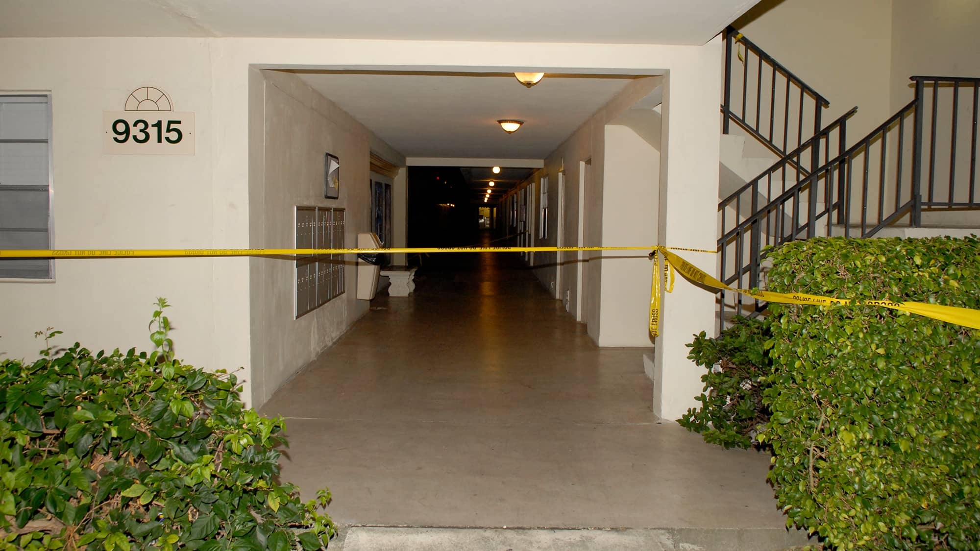 Bryan Pata's apartment building with crime scene tape