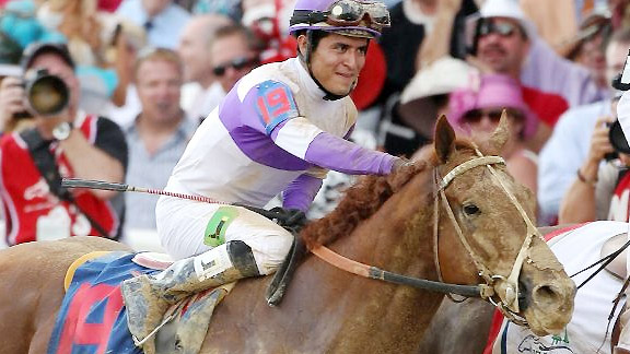 Jockey Mario Gutierrez on I'll Have Another in the Kentucky Derby winner's circle.